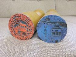 デザインは谷享司さんと井上博司さんの二人が担当。彫りは事務局の石嶋が担当。